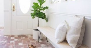 The sweetest entryway. Love the clean white and natural elements and brick floor...